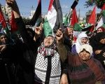 Palestinian women attend a rally calling for an end to Palestinian divisions to mark International Women's Day, in Gaza City, Gaza, March 8, 2011.