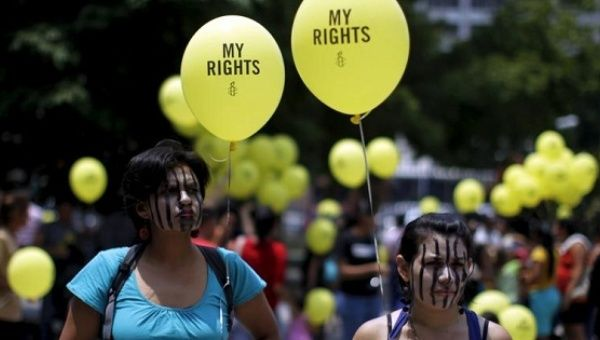 Women take part in a demonstration against anti-abortion laws in San Salvador on April 22, 2015.