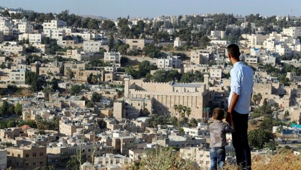 A general view as Palestinians look at the West Bank city of Hebron July 7, 2017.