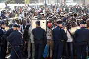 French police loaded 2,771 people, including dozens of unaccompanied children into vans and coaches at dawn on Friday.