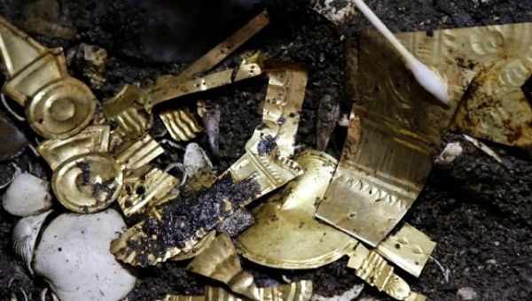 Gold pieces formed into symbols are seen at a site at one of the main Aztec temples, in Mexico City, Mexico, June 22, 2017