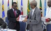 Dr. Keith Mitchell of Grenada receives a Blood Pressure Apparatus from Caricom Assistant Secretary-General Human and Social Development, Dr. Douglas Slater.