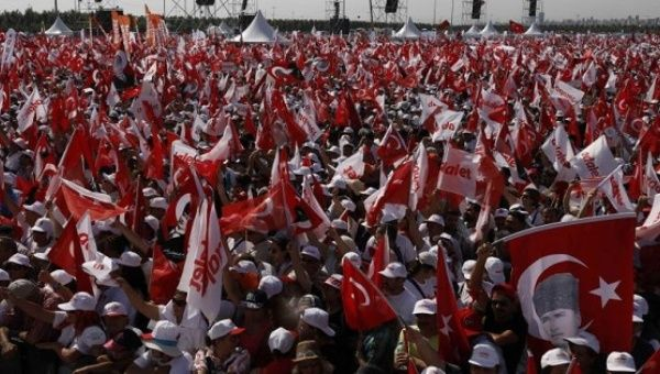 People wave Turkish flags during a rally to mark the end of the main opposition leader Kemal Kilicdaroglu