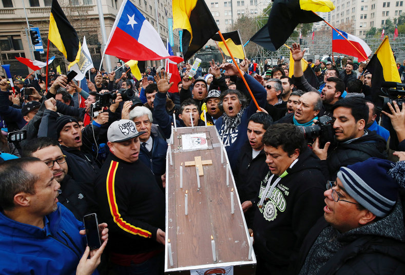 Angry taxi drivers hold a mock funeral for Uber and Cabify in Santiago, Chile.