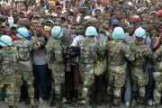 UN soldiers control Haitians queuing for aid at a distribution point outside of the Presidential Palace in Port-au-Prince two weeks after the earthquake, on Jan. 25, 2010.