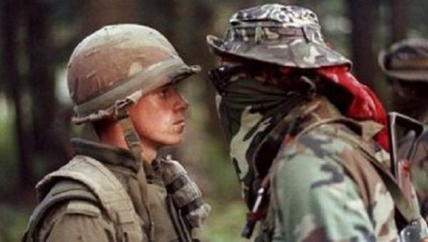 "Private Patrick Cloutier and Anishinaabe warrior Brad ""Freddy Krueger"" Larocque face off during the crisis in July 1990."