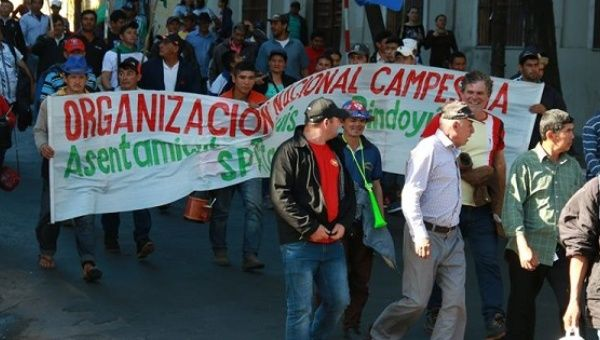 Thousands of campesinos marched in the center of Asuncion on Wednesday.