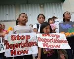Children take part in an immigrant defense rally.