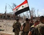 Syrian Arab Army members patrol a liberated area.