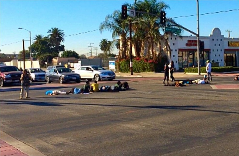 "BLM Los Angeles chapter stage a ""die-in"" in Compton to protest the use of assault rifles that police officers carry on school campuses."