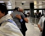 International passengers embrace family members as they arrive at Washington Dulles International Airport in Dulles, Virginia, U.S., on June 29, 2017.