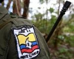 A member of the 51st Front of the Revolutionary Armed Forces of Colombia, FARC, is seen at a camp in Cordillera Oriental, Colombia.