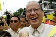 Former Philippine President Benigno Aquino smiles as he is welcomed by supporters in Quezon city, metro Manila, Philippines, on June 30, 2016.