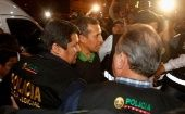 Former Peruvian president Humala is escorted by police.