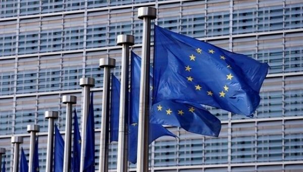European Union flags outside the EU Commission headquarters in Brussels, Belgium.