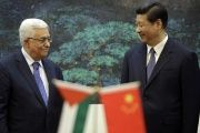 China's President Xi Jinping (L) greets Palestinian counterpart Mahmoud Abbas in Beijing. (FILE)