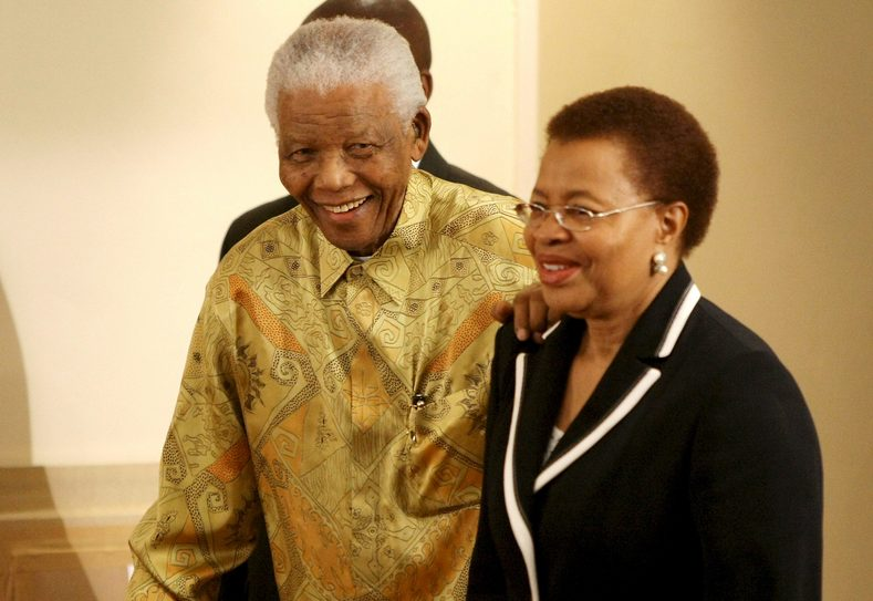 Nelson Mandela and his wife Graca Mandela attend a luncheon to celebrate his 90 birthday in 2008