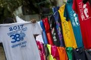 A child holds a T-Shirt commemorating the anniversary of the Sandinist Revolution in an improvised shop set up in the streets of Managua, Nicaragua.