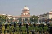 A television journalist sets his cameras inside the premises of the Supreme Court in New Delhi, India, on February 18, 2014.