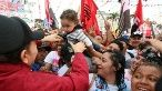 Nicaragua's President Daniel Ortega greets a child at the celebrations marking the Sardinista Revolution