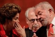 Former Brazilian President Dilma Rousseff speaks to Luiz Inacio Lula da Silva during the inauguration of the new National Directory of the Workers' Party, in Brasilia, Brazil July 5, 2017.