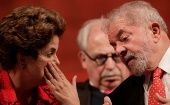 Former Brazilian President Dilma Rousseff speaks to Luiz Inacio Lula da Silva during the inauguration of the new National Directory of the Workers