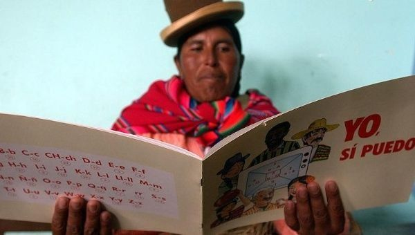 "A Bolivian woman learns to read from a book called ""Yes I Can."""