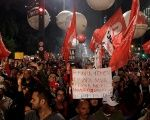 People attend a protest against the conviction on corruption charges of former president Luiz Inacio Lula da Silva, in Sao Paulo