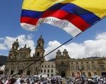 Citizens in Colombia rally to march in support of the peace process between the FARC and Colombian government.