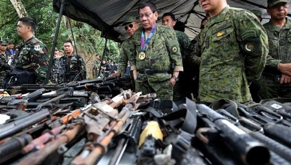 Philippine President Rodrigo Duterte inspects firearms together with Eduardo Ano, Chief of Staff of the Armed Forces, during his visit at the military camp in Marawi city, southern Philippines July 20, 2017.
