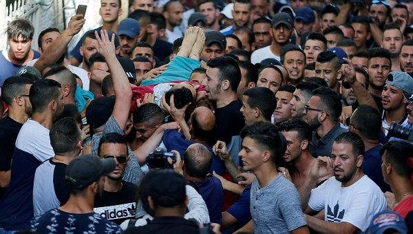 Mourners carry the body of Palestinian Mohammad Abu Ghannam during his funeral in the East Jerusalem neighbourhood of A-tur July 21, 2017
