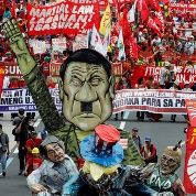 Protesters display an effigy of President Rodrigo Duterte during a march towards the Philippine Congress ahead of Duterte