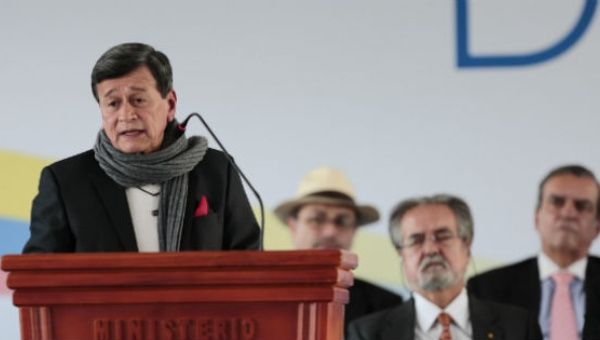 Pablo Beltran (left), leader of the ELN speaks at the inauguration of peace negotiations with the Colombian government in February.