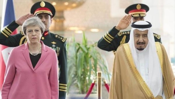 British PM Theresa May (L) with Saudi King Salman (R).