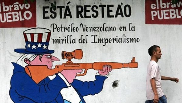 "A mural in Caracas reads, ""The courageous people will defend Venezuelan oil in imperialism"