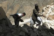 Afghan miners work on an emerald mine in the mountains of the Panjshir valley north of Kabul on April 20, 2007.