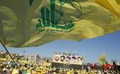 Hezbollah supporters wave the group