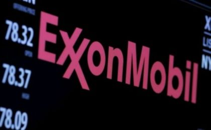 The logo of ExxonMobil Corporation is shown on a monitor above the floor of the New York Stock Exchange.