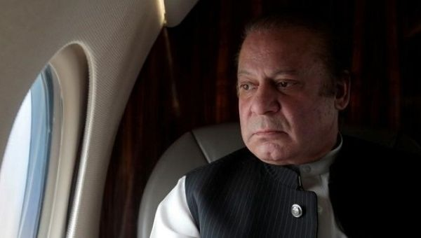 Pakistani Prime Minister Nawaz Sharif looks out the window of his plane on February 3, 2017.