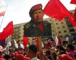 Supporters hold a poster of the late President Hugo Chavez.