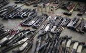 Detail of the 267 firearms that Salvadoran gang members delivered to the authorities in Apopa, El Salvador, on March 9, 2013.