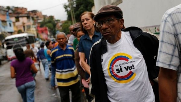 People wait to cast their vote at a polling station during the Constituent Assembly election in Caracas.