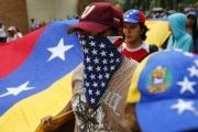 A Venezuelan opposition protester wearing a U.S. flag.