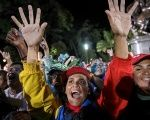 Supporters of President Maduro celebrate the election results in Caracas