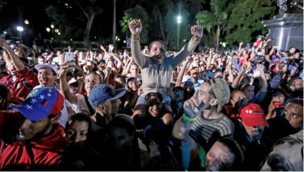Venezuelans celebrate in Bolivar square after the country