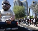 An effigy showing Maricopa County Sheriff Joe Arpaio in handcuffs is on parade at a protest in downtown Phoenix on November 8, 2016.
