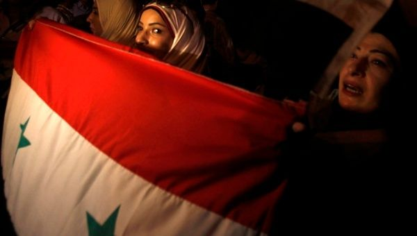 Syrian protesters living in Egypt take part in a demonstration in support of President Bashar al-Assad.