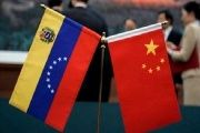 The flags of Venezuela and China.