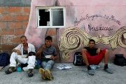 Migrants from Central America eat outside of a migrant shelter in Tabasco, Mexico.