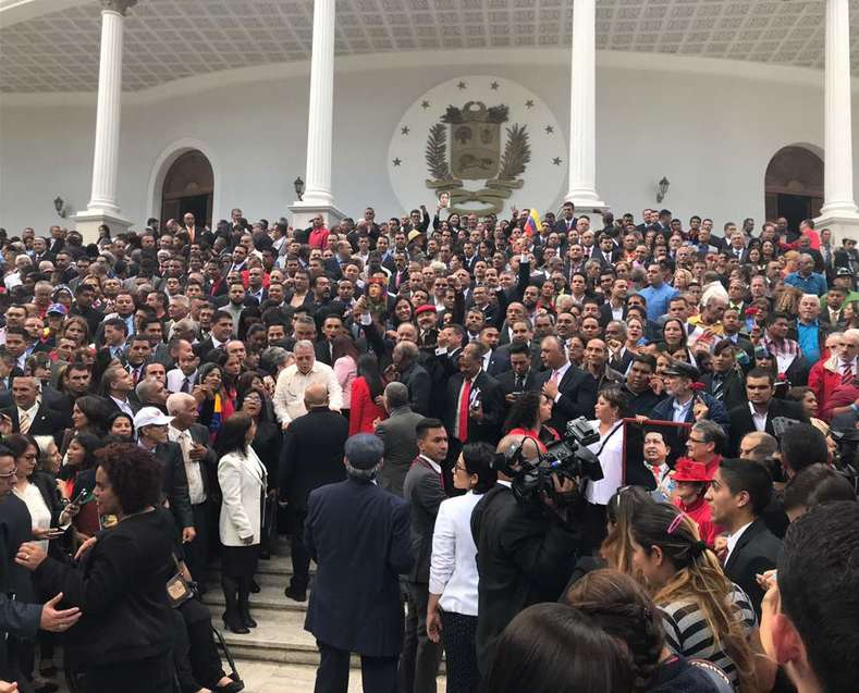 The newly-elected members of the National Constituent Assembly gather outside of the Federal Legislative Palace in Caracas after being sworn-in